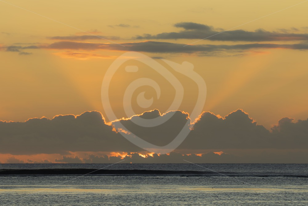 Mauritian sunset with shining clouds - Nature Stock Photo Agency